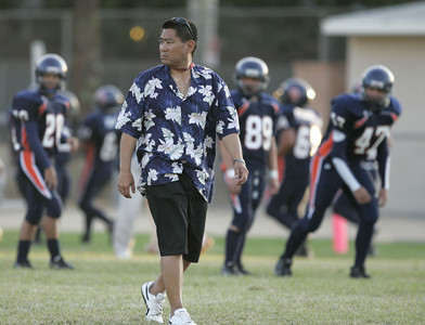 Chatsworth's Head Football Coach Rick Hayashida walks on the field before the game against Chaminade on Thursday, September 20, 2007 at Chatsworth High School. (Edna T. Simpson)