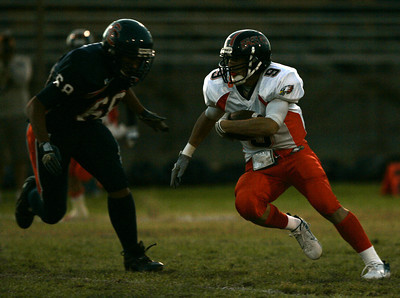 Chaminade's Tim Rowley tries to get away from Chatsworth's Edward Rubio during the first half on Thursday, September 20, 2007 at Chatsworth High School. (Edna T. Simpson)