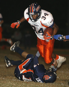 Chaminade's Chris Warren gets tackled by Chatsworth's Michael Locurto during the first half on Thursday, September 20, 2007 at Chatsworth High School. (Edna T. Simpson)