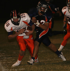 Chaminade Ryan Griffin gains yardage before getting tackled by  Chatsworth's Anthony Flores during the first half on Thursday, September 20, 2007 at Chatsworth High School. (Edna T. Simpson)