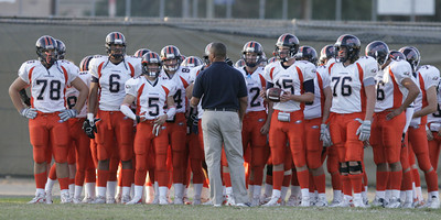 Chaminade Head Coach Anthony Harris giving his players instructions before the game against Chatsworth at Chatsworth High School, on Thursday, September 20, 2007. (Edna T. Simpson)