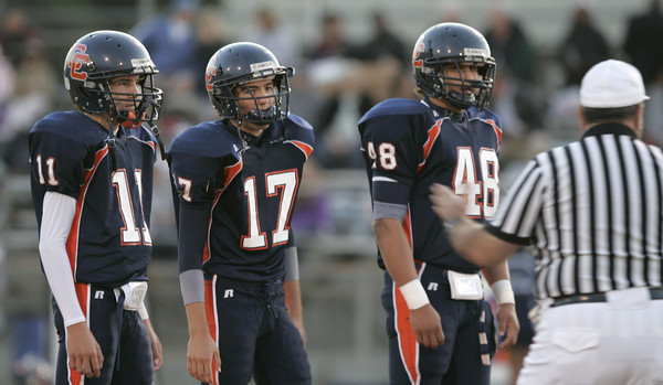 Referee giving Chatsworth's Captains of the team instructions before the game against Chaminade High School. #11 John Cardona, #17 Michael Locurto and #48 Thomas Franco  on Thursday, September 20, 2007 at Chatsworth High School. (Edna T. Simpson)