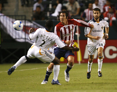 Chivas Sacha Kljestan in action with Galaxy Mike Randolph during the first half on Thursday, September 13, 2007 at Home Depot Center. (Edna T. Simpson)