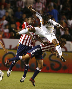 Galaxy Carlos Pavon in action with Chivas Shavar Thomas and Jesse Marsch during the first half of victory game on Thursday, September 13, 2007 at Home Depot Center. (Edna T. Simpson)