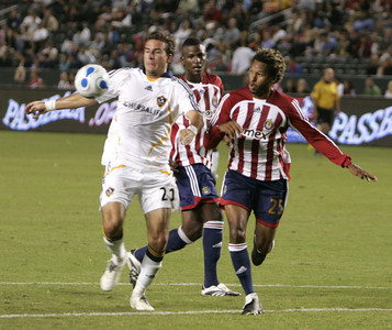 Galaxy  Alan Gordon  in action with Chivas Lawson Vaughn for control of ball during the second half on Thursday, September 13, 2007 at Home Depot Center. (Edna T. Simpson)