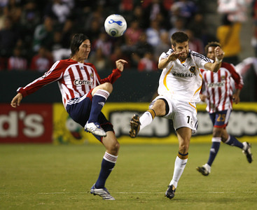Chivas Sacha Kljestan battles Galaxy Kyle Martino for control of ball during the first half on Thursday, September 13, 2007 at Home Depot Center. (Edna T. Simpson)