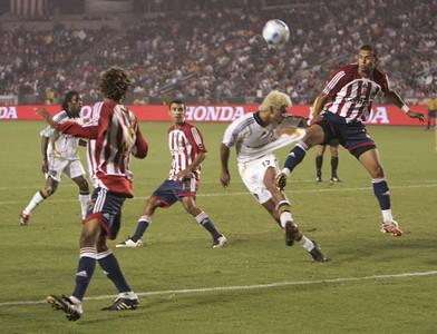 Chivas Jason Hernandez jumps up high in air against Galaxy Abel Xavier during the second half on Thursday, September 13, 2007 (Edna T. Simpson)