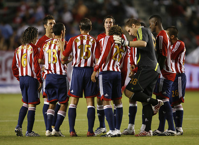 Chivas players in  a huddle before the game against Galaxy on Thursday, September 13, 2007 at Home Depot Center. (Edna T. Simpson)