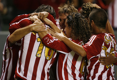 Chivas Ante Razov celebrates with teammates after making the first goal of the game during the first half on Thursday, September 13, 2007 at Home Depot Center. (Edna T. Simpson)