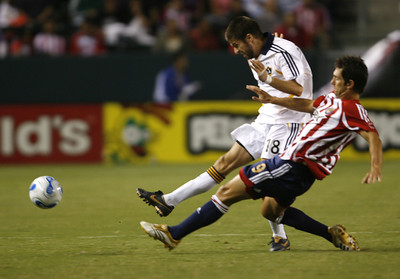 Chivas Ante Razov goes up against Galaxy Kyle Martino for control of ball during the first half on Thursday, September 13, 2007 at Home Depot Center. (Edna T. Simpson)