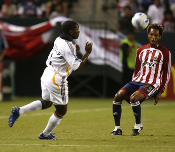 Chivas Lawson Vaughn go up for a header against Galaxy Mike Randolph during the first half on Thursday, September 13, 2007 at Home Depot Center. (Edna T. Simpson)