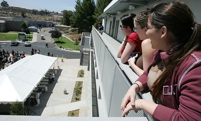 (L-R) College of the Canyons science students Jessica Serata, Brittany Heimann and Sandra Miliotti watch from the third floor as the school held a ribbon cutting ceremony on Wednesday, July 11, 2007 in Valencia, CA, to officially announce the 43,000 square-foot Aliso Hall & Laboratory building that will be used for a variety of scientific, biological and medical courses available to students with cutting edge equipment and topics. (John Lazar/L.A. Daily News Staff Photographer)