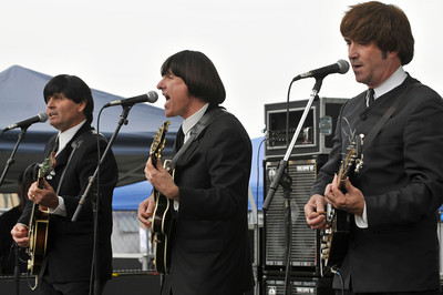 "Beatles tribute band ""Beatlemania,"" plays as the 27th Annual CALIFORNIA STRAWBERRY FESTIVAL gets underway this weekend May 15 and 16, 2010 at Strawberry Meadows of College Park in Oxnard. Ranking among the top Festivals in the nation, the fruitful celebration boasts strawberries every way  imaginable, along with all day fun for the entire family with concert performances, the Strawberry Promenade with celebrity cooking demonstrations, more than 200 Fine Arts & Crafts booths, Strawberryland For Kids with rides and attractions, gooey contests, and more.  Oxnard,CA. 5/15/2010. photo by John McCoy/staff photographer"