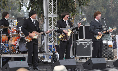 Beatles Tribute band Beatlemania play as the 27th Annual CALIFORNIA STRAWBERRY FESTIVAL gets underway this weekend May 15 and 16, 2010 at Strawberry Meadows of College Park in Oxnard. Ranking among the top Festivals in the nation, the fruitful celebration boasts strawberries every way  imaginable, along with all day fun for the entire family with concert performances, the Strawberry Promenade with celebrity cooking demonstrations, more than 200 Fine Arts & Crafts booths, Strawberryland For Kids with rides and attractions, gooey contests, and more.  Oxnard,CA. 5/15/2010. photo by John McCoy/staff photographer