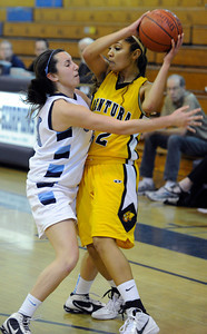 Camarillo#21 Samantha Pericon-Kapp guards Ventura#22 Kayalin Aikens-Irby. The Camarillo Girls Basketball team played host to Ventura defeating them 56 to 52. Camarillo, CA 1/7/2012(John McCoy/Staff Photographer)