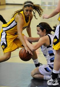 Ventura#22 Kayalin Aikens-Irby and Camarillo#21 Samantha Pericon-Kapp scrap for the ball. The Camarillo Girls Basketball team played host to Ventura defeating them 56 to 52. Camarillo, CA 1/7/2012(John McCoy/Staff Photographer)