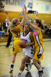 Camarillo#13 Dynn Leaupepe spilts Ventura#31 Haley Litten and Ventura#40 Natalie McCambridge. The Camarillo Girls Basketball team played host to Ventura defeating them 56 to 52. Camarillo, CA 1/7/2012(John McCoy/Staff Photographer)