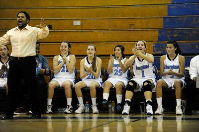 Camarillo Head Coach Michaeltore Smith and the bench cheer during the final seconds of the game. The Camarillo Girls Basketball team played host to Ventura defeating them 56 to 52. Camarillo, CA 1/7/2012(John McCoy/Staff Photographer)