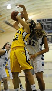Ventura#22 Kayalin Aikens-Irby gets blocked by Camarillo#12 Lynn Leaupepe. The Camarillo Girls Basketball team played host to Ventura defeating them 56 to 52. Camarillo, CA 1/7/2012(John McCoy/Staff Photographer)