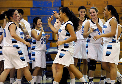 A victorious Camarillo team celebrates. The Camarillo Girls Basketball team played host to Ventura defeating them 56 to 52. Camarillo, CA 1/7/2012(John McCoy/Staff Photographer)