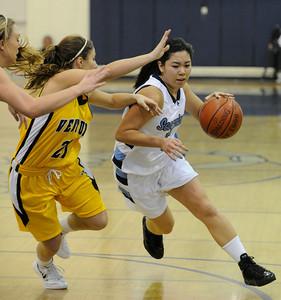 Camarillo#5 Kristi Nishimori drives the lane around Ventura#21 Christina Shafer. The Camarillo Girls Basketball team played host to Ventura defeating them 56 to 52. Camarillo, CA 1/7/2012(John McCoy/Staff Photographer)