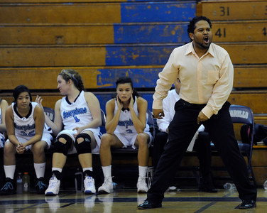 Camarillo Head Coach Michaeltore Smith cheers his ladies on in the final moments. The Camarillo Girls Basketball team played host to Ventura defeating them 56 to 52. Camarillo, CA 1/7/2012(John McCoy/Staff Photographer)