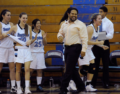 Camarillo Head Coach Michaeltore Smith and the bench cheer after the final buzzer sounds. The Camarillo Girls Basketball team played host to Ventura defeating them 56 to 52. Camarillo, CA 1/7/2012(John McCoy/Staff Photographer)