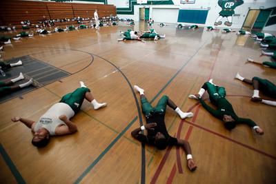 Canoga High School football players stretch in the gym before their game against Washington Prep at Canoga Park High School Wednesday, September 1, 2010. (Hans Gutknecht/Staff Photographer)