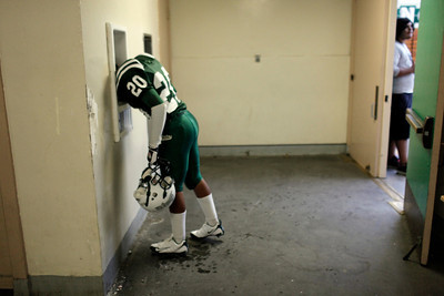 Canoga Park High School's Antonio Lopez gets a drink of water before their game against Washington Prep at Canoga Park High School Wednesday, September 1, 2010. (Hans Gutknecht/Staff Photographer)