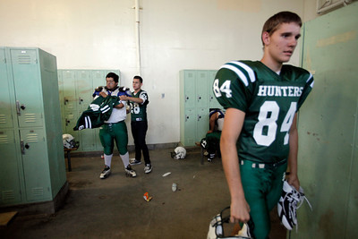 Canoga Park High School players get ready in the locker room before their game against Washington Prep game at Canoga Park High School Wednesday, September 1, 2010. (Hans Gutknecht/Staff Photographer)