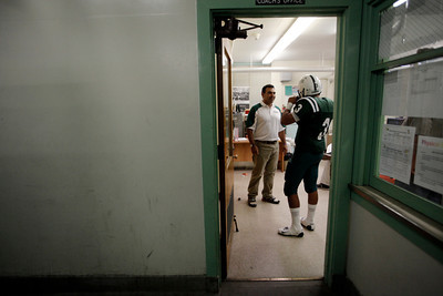 Canoga Park High School head coach Ivan Moreno talks to player Vince Orejel in the locker room before their game against Washington Prep at Canoga Park High School Wednesday, September 1, 2010. (Hans Gutknecht/Staff Photographer)