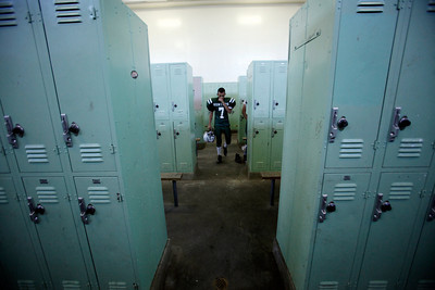 Canoga Park High School's JC Hernandez gets ready in the locker room before their game against Washington Prep at Canoga Park High School Wednesday, September 1, 2010. (Hans Gutknecht/Staff Photographer)