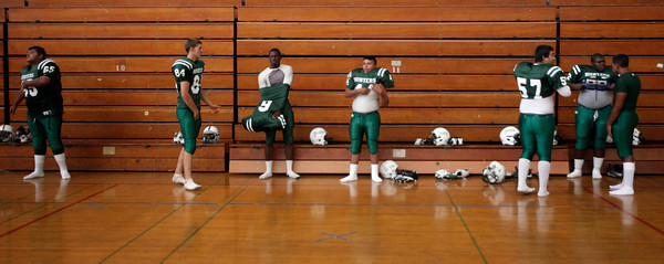 Canoga Park High School football players get ready in the gym before their game against Washington Prep at Canoga Park High School Wednesday, September 1, 2010. (Hans Gutknecht/Staff Photographer)