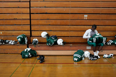 Canoga Park High School's Randy Uzoma prepares his equipment before their game against Washington Prep at Canoga Park High School Wednesday, September 1, 2010. (Hans Gutknecht/Staff Photographer)