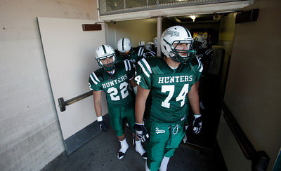 Canoga Park High School's football team prepares to take the field before their game against Washington Prep at Canoga Park High School Wednesday, September 1, 2010. (Hans Gutknecht/Staff Photographer)
