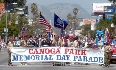 The start of the Canoga Park Memorial Day Parade on Monday, May 28, 2007.  The banner was carried by the cub and boy scouts of West Hills.  (Tina Burch/Staff Photographer)