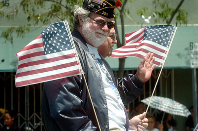 American Legion Commanders left to right are Tom Heverly, a veteran from Vietnam War, and Charlie Wise, veteran from the Korean War, wave to parade goers during the 19th Annual Canoga Park Memorial Day Parade on Monday, May 28, 2007.  (Tina Burch/Staff Photographer)