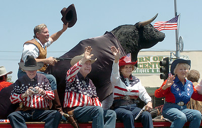 Actor Mike Shanto of Reel Cowboys rides a mechanical bull during the 19th Annual Canoga Park Memorial Day Parade on Monday, May 28, 2007.  (Tina Burch/Staff Photographer)