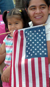 Jasmine Mendez, 22-months-old, and her mother, Emma Mendez, 39, from Canoga Park, watch the 19th Annual Canoga Park Memorial Day Parade on Monday, May 28, 2007.  ( Tina Burch/Staff Photographer)