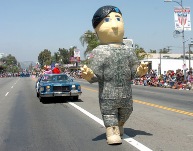 During the 19th Annual Canoga Park Memorial Day Parade, a man inside a giant army man blowup, walks down Sherman Way on Monday, May 28, 2007.  (Tina Burch/Staff Photographer)