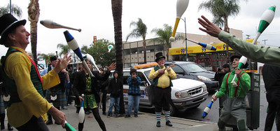St. Patrick's Day was celebrated in Canoga Park, CA with a sidewalk parade, music and storytelling.  Light rain fell as the group moved from the Madrid Theater past Follow Your Heart along Sherman Way, Saturday March 17, 2012.  Jugglers with the Jumbo Shrimp Circus perform at the end of the parade.  (Dean Musgrove/Staff Photographer)