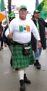 St. Patrick's Day was celebrated in Canoga Park, CA with a sidewalk parade, music and storytelling.  Light rain fell as the group moved from the Madrid Theater past Follow Your Heart along Sherman Way, Saturday March 17, 2012. Gary Wales proudly wears his kilt duribg the parade. (Dean Musgrove/Staff Photographer)