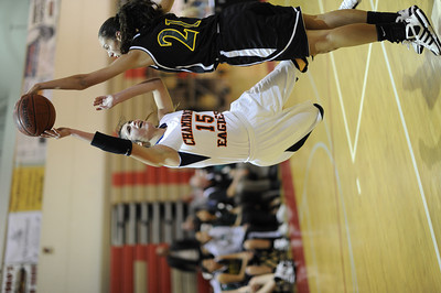 Chaminade's Kaylie Fandino (15) shoots as Canyon's Jaya Schultz (21) defends during their first round game in  the West Coast Holiday Festival invitational division at Burroughs High School in Burbank Monday, December 26, 2011. (Hans Gutknecht/Staff Photographer)