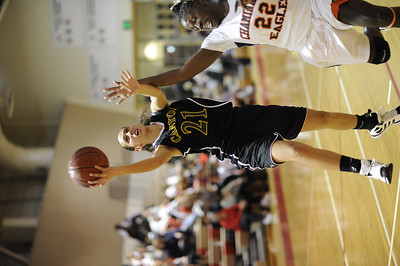 Canyon's Jaya Schultz (21)  goes to the hoop during their game against Chaminade in the first round of the West Coast Holiday Festival invitational division at Burroughs High School in Burbank Monday, December 26, 2011. (Hans Gutknecht/Staff Photographer)
