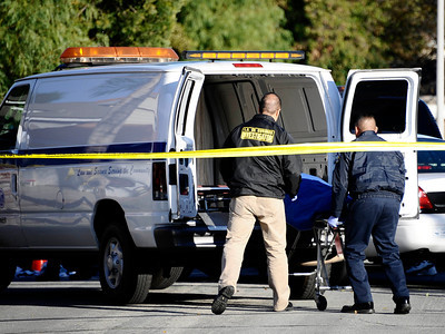 Investigators from the Los Angeles County Coroner's Office remove the body of an 89-year-old woman after she was struck and killed by an auto as it was backing out of the driveway at 19821 Buttonwillow Drive in Winnetka on Nov. 28, 2010. (Gene Blevins/Special to the Daily News)