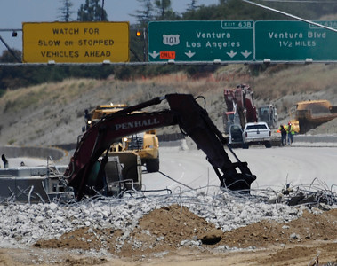 Construction teams work on the demolishing the Mulholland Dr. bridge over the 405 freeway on the first day of carmageddon. Los Angeles CA  July 16,2011. Photo by Gene Blevins/LA Daily News