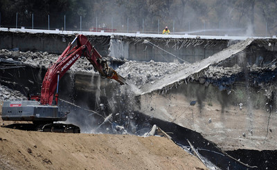 Huge pieces of concrete come falling down as construction teams work on the demolishing the Mulholland Dr. bridge over the 405 freeway on the first day of carmageddon. Los Angeles CA  July 16,2011. Photo by Gene Blevins/LA Daily News