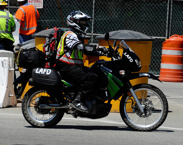 LA city fire paramedics patrol on motor cycles as construction teams work on the demolishing the Mulholland Dr. bridge over the 405 freeway on the first day of carmageddon. Los Angeles CA  July 16,2011. Photo by Gene Blevins/LA Daily News