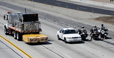 CHP patrol the 405 at the 101 freeway  as construction teams work on the demolishing the Mulholland Dr. bridge over the 405 freeway on the first day of carmageddon. Los Angeles CA  July 16,2011. Photo by Gene Blevins/LA Daily News