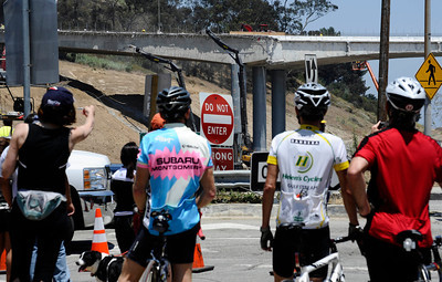 BIkers had the roads to them selfs as they stop to check out the construction teams work on the demolishing the Mulholland Dr. bridge over the 405 freeway on the first day of carmageddon. Los Angeles CA  July 16,2011. Photo by Gene Blevins/LA Daily News